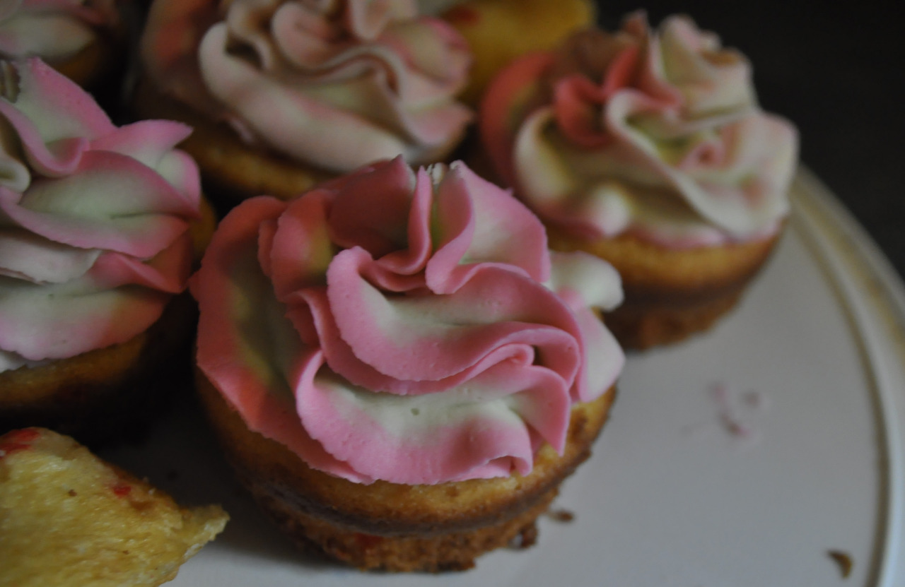 Strawberry buttercream frosting funfetti cupcakes I made, seeing your blog makes me want to bake again!